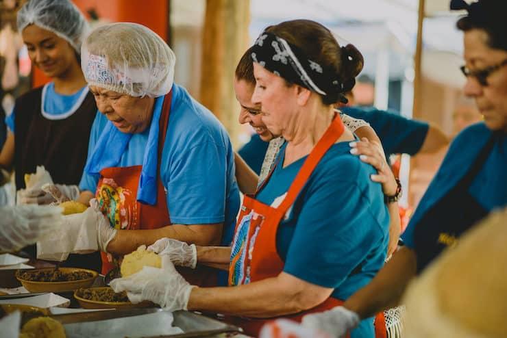 guadalupanas and carmelitas volunteers making Gorditas at church festival