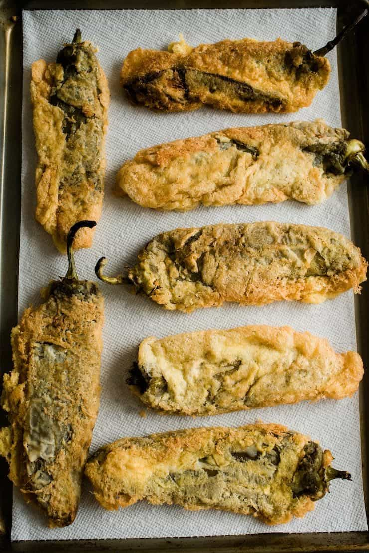 Chile Rellenos draining on a baking sheet lined with paper towels