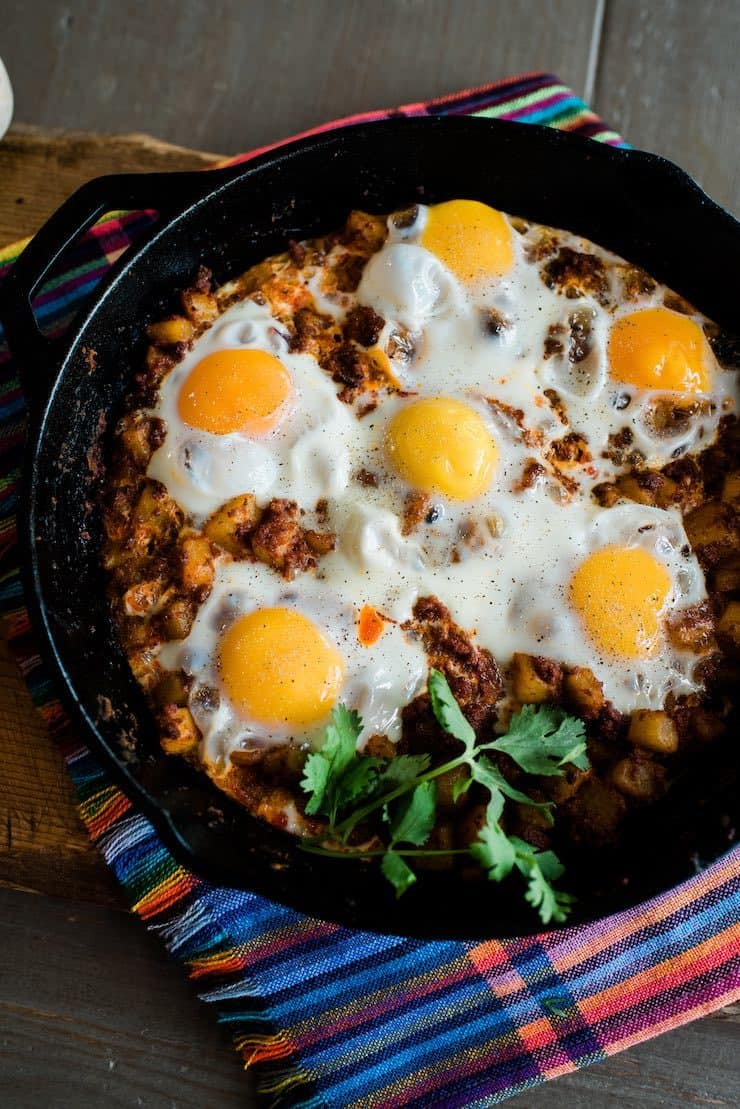 Baked Eggs with Chorizo and Potatoes showcasing deep golden egg yolks from free range eggs