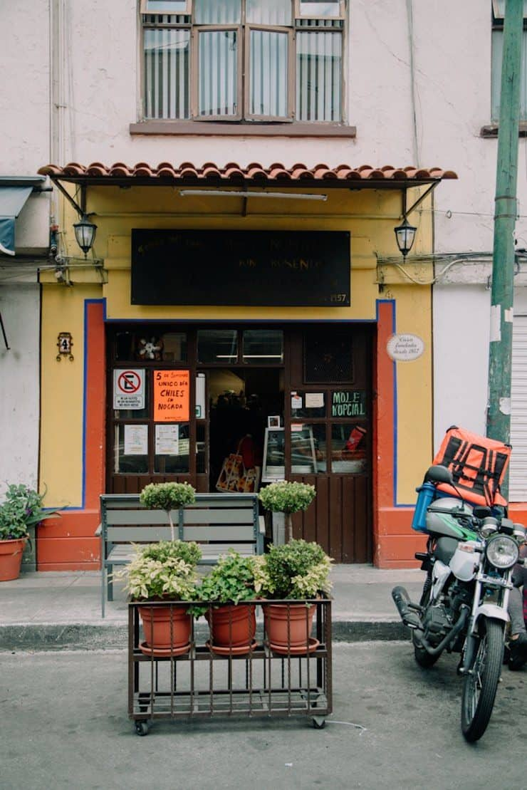 street view of a Mexican restaurant in Mexico City with a motorcycle in front