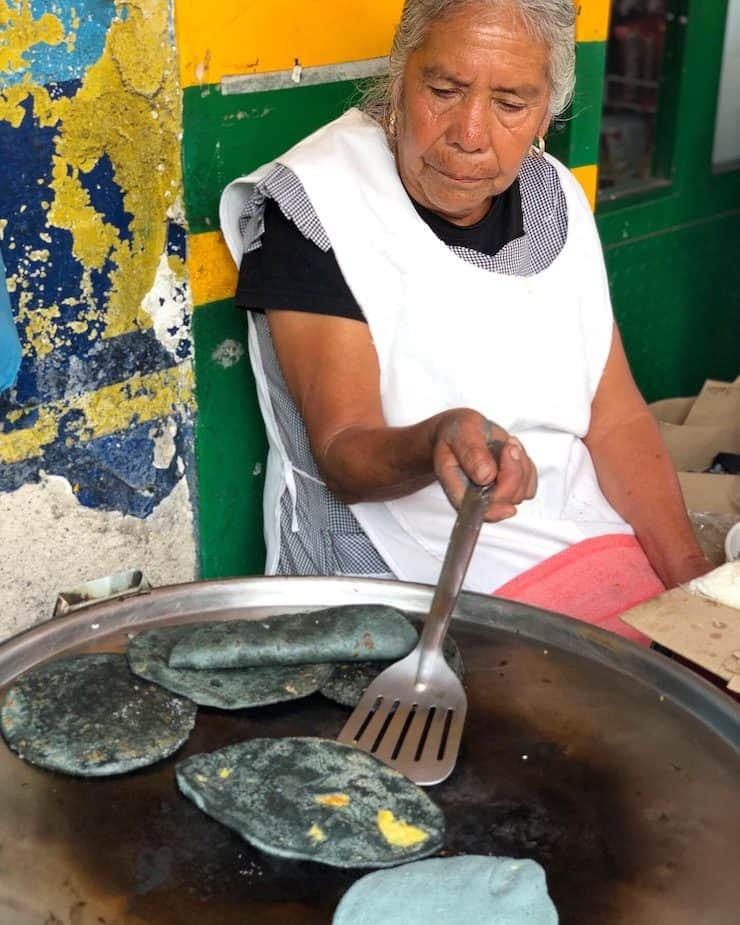 Tlacoyos made by Doña Rosa in Mexico City street food vendor
