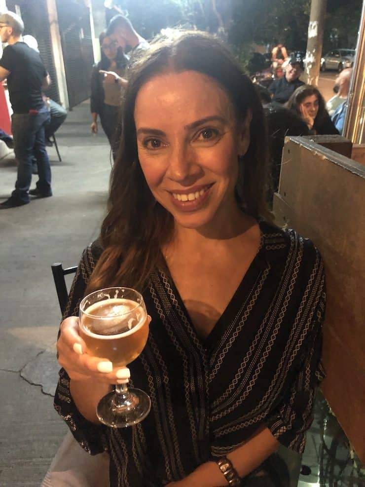 Latina holding a microbrew beer in Mexico City
