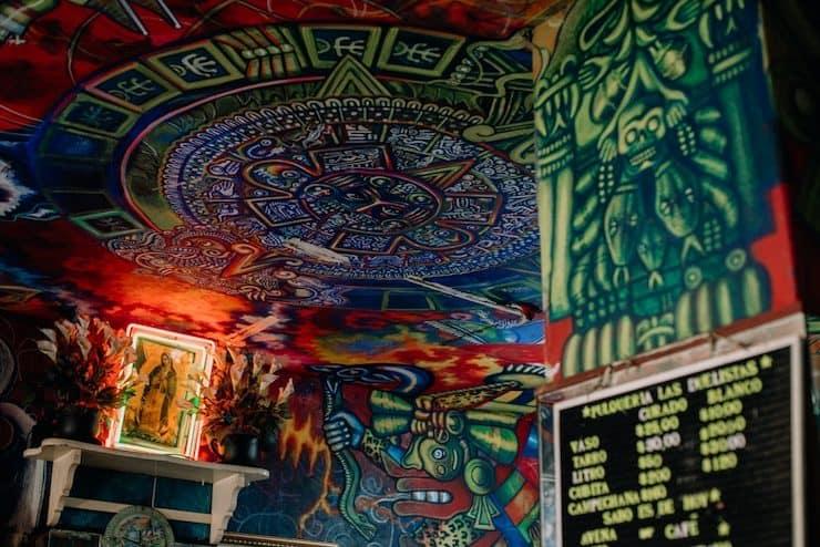 colorful Mayan Aztec artwork at Pulquería Las Duelistas