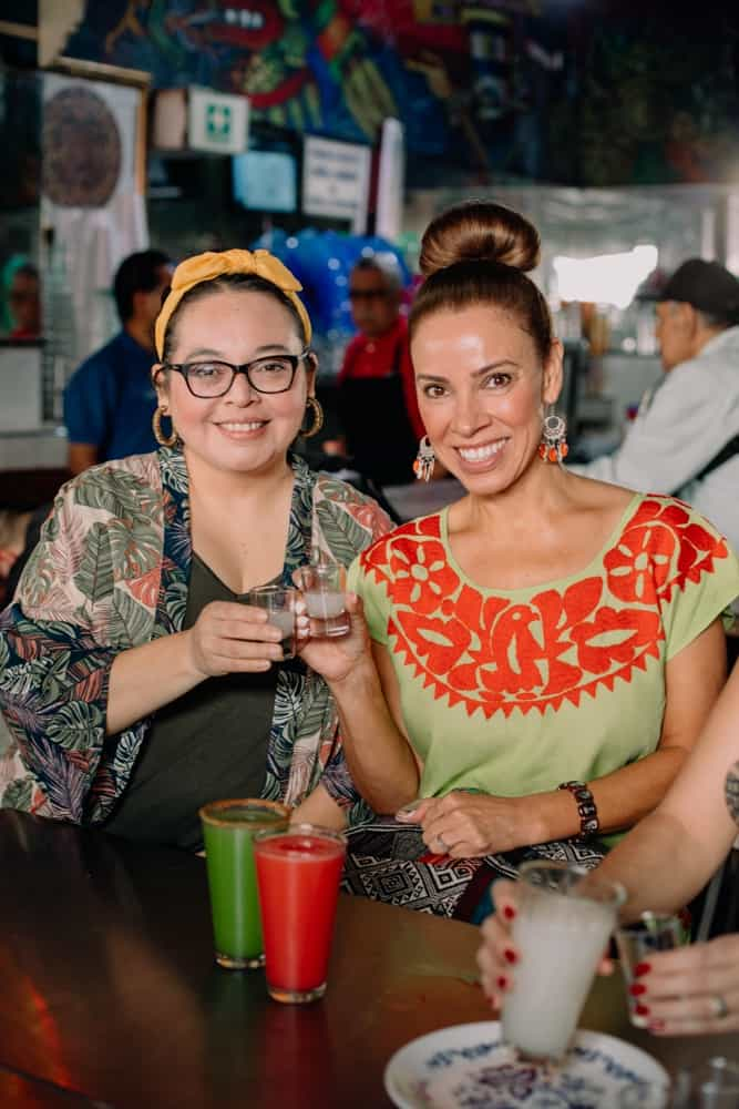 Food and travel bloggers enjoying pulque
