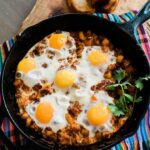 overhead shot of a breakfast egg skillet with chorizo and potaoes