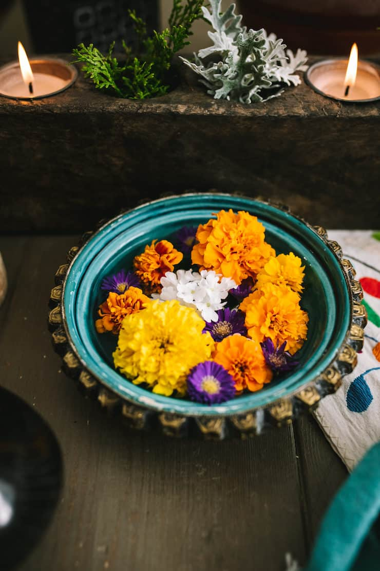 marigold flowers floating in a bowl represent of water to absorb bad energy