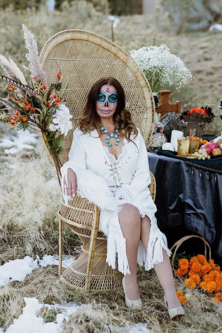 catrina makeup dress dia de Los Muertos sitting on vintage chair