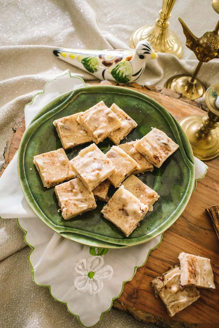 Butter Pecan Bourbon Fudge on a green plate with Christmas decor