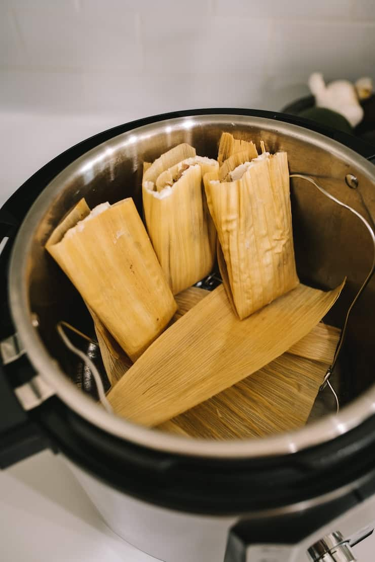 steaming tamales in an Instant Pot Pork and Roasted Green Chile Tamales