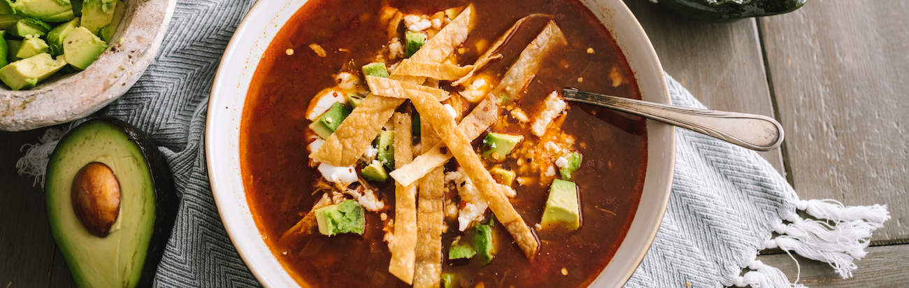 chicken tortilla soup in a white bowl