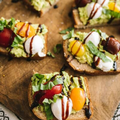 Heart-Healthy Caprese Avocado Toast served on a wooden board