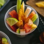 Serving delicious Mexican Fruit Cups