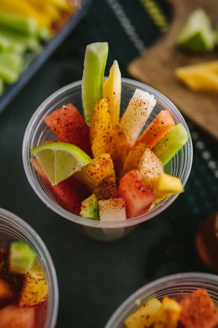 Mexican fruit cups sprinkled with Tajin