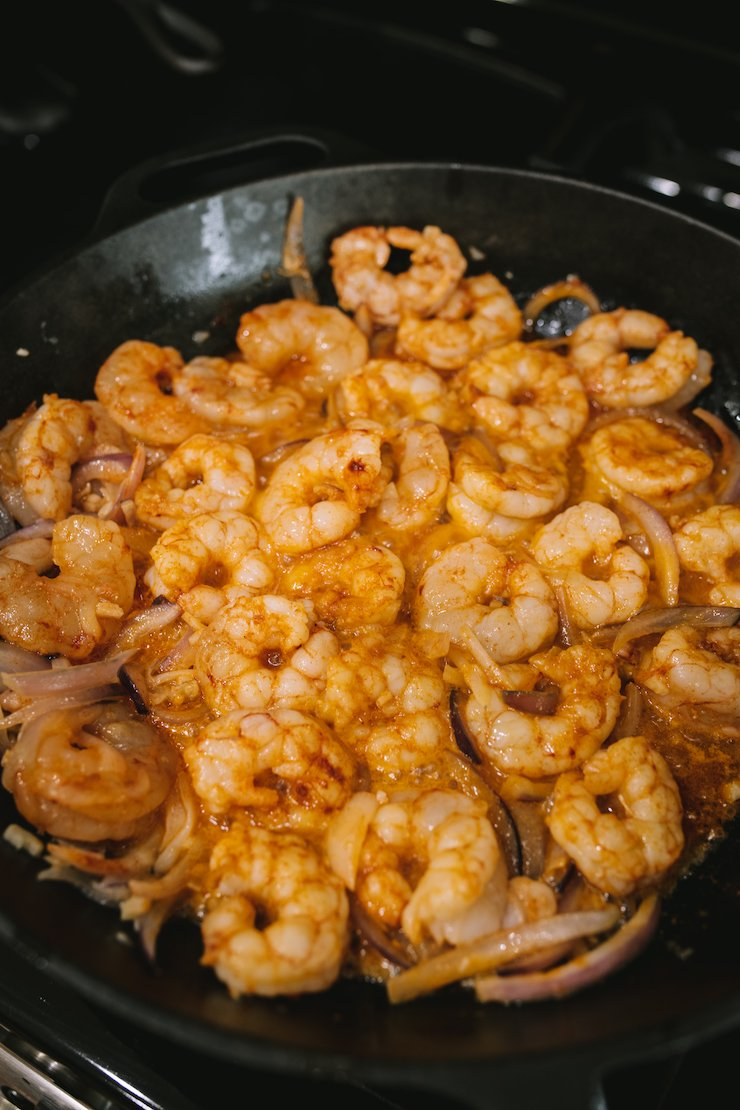 buttery shrimp in a skillet Camarones al Mojo de Ajo (Mexican-Style Garlic Shrimp)