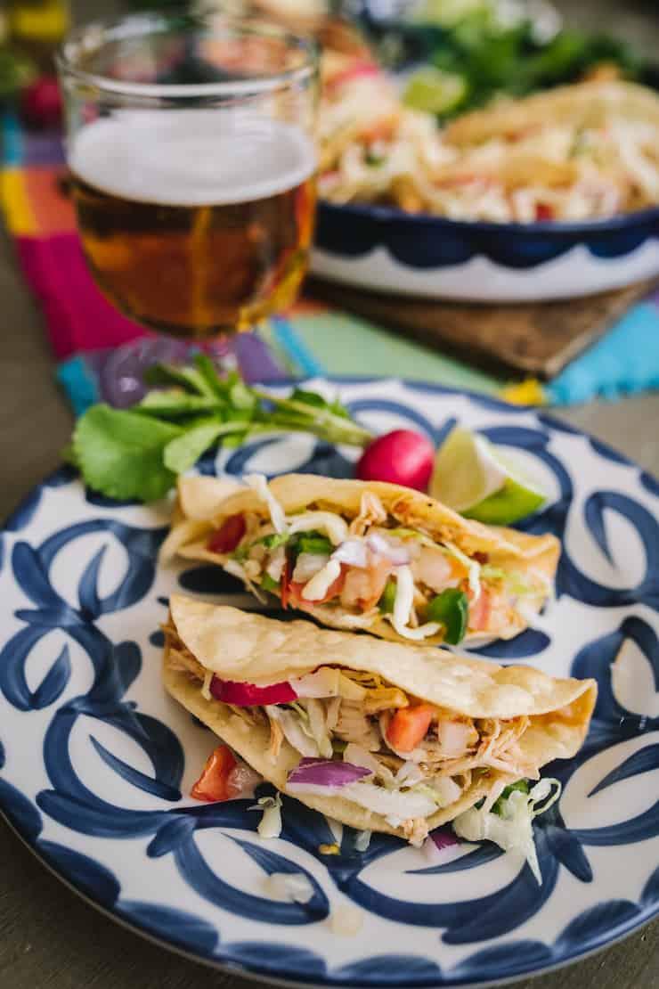 crispy chicken tacos and a cerveza beer