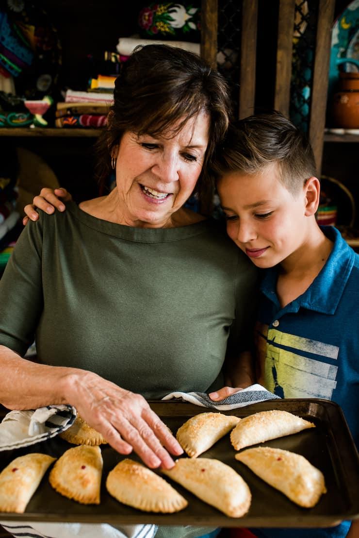 grandma and grandson Cherry Empanadas (Cherry Hand Pies)