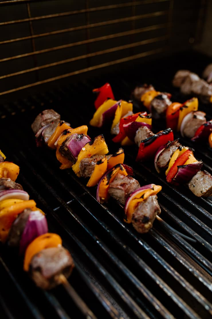 grilling Steak Fajita Skewers on a grill with char grill marks