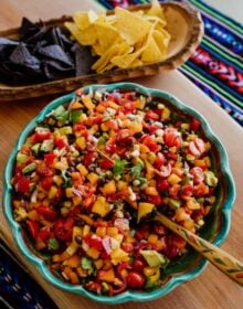 texas Cowboy Caviar in a bowl with chips on the side in a wooden bowl