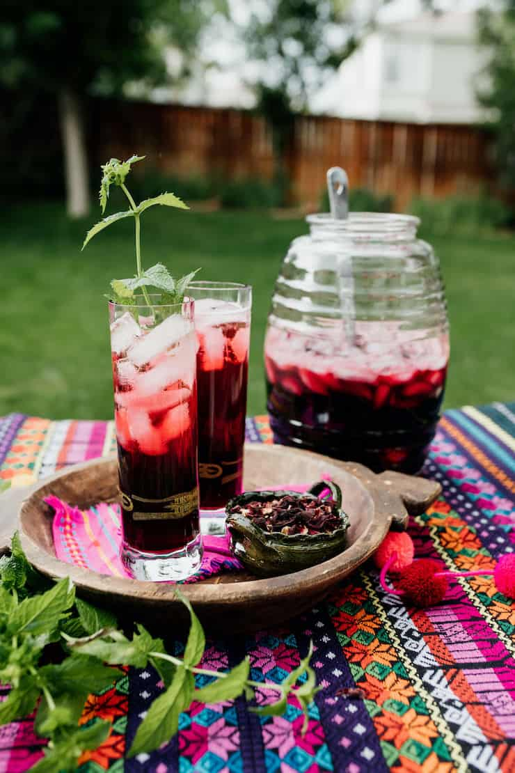 Serving Agua de Jamaica or Hibiscus Tea outside with a beautiful background