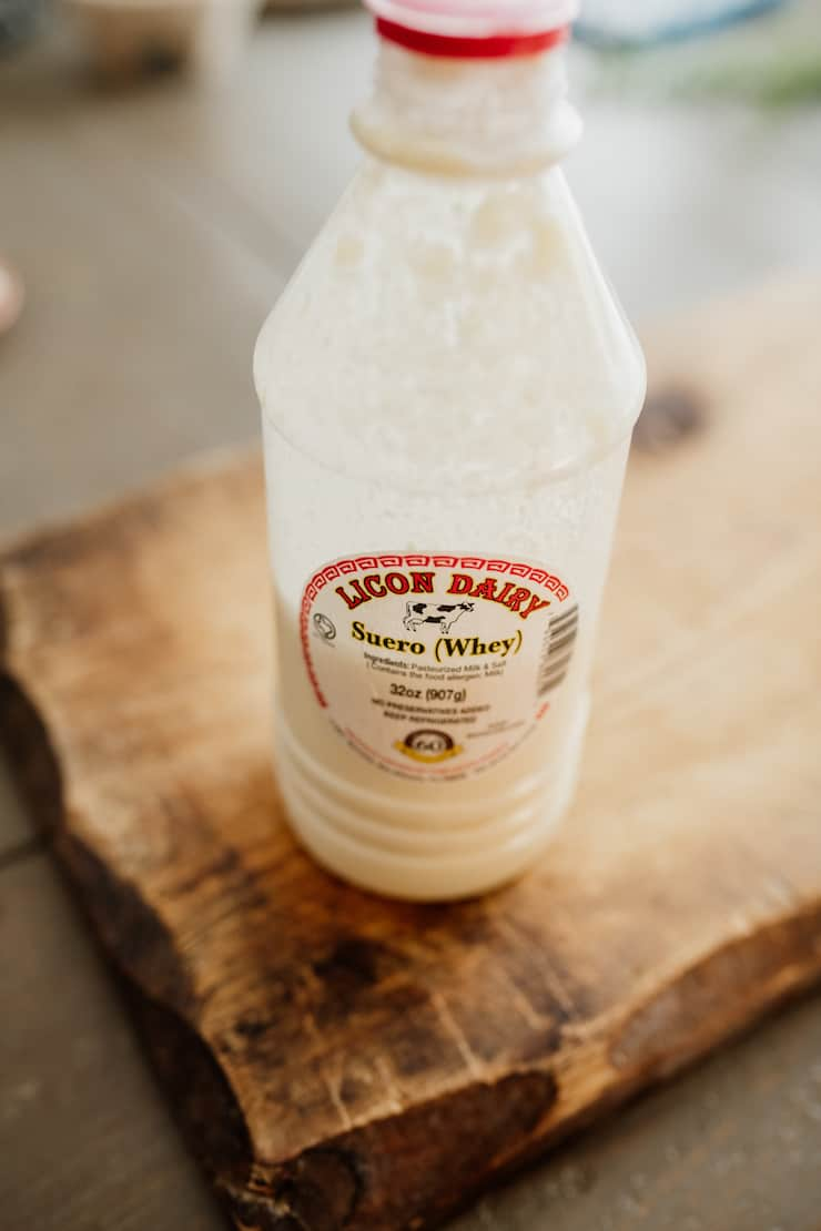 plastic bottle of suero (whey) from Licon Dairy on a wooden board