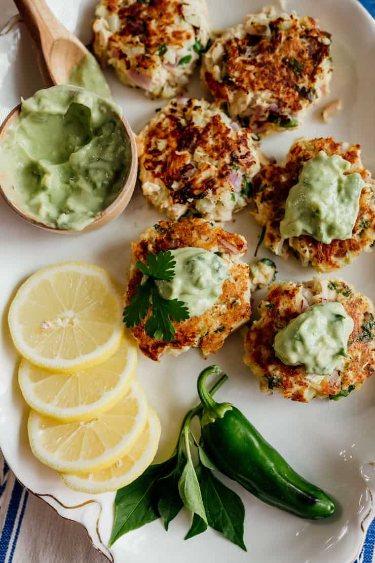 tuna patties dolloped with avocado Crema sauce