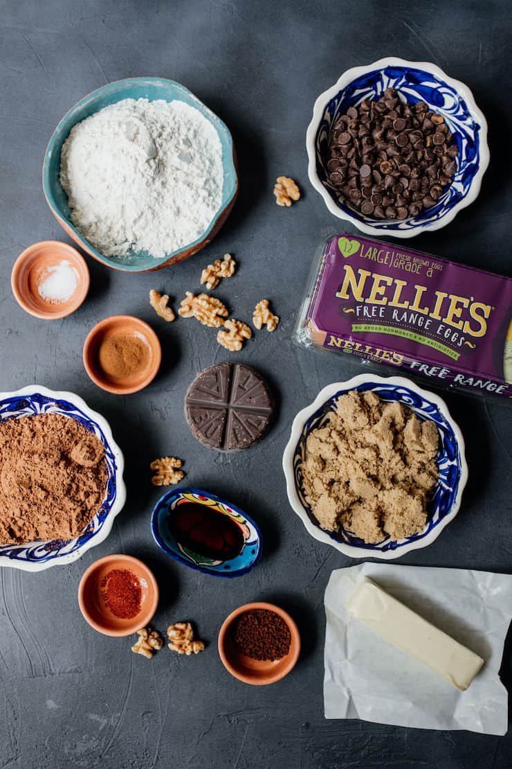 bowls of ingredients to make brownies including Nellies eggs on a black background