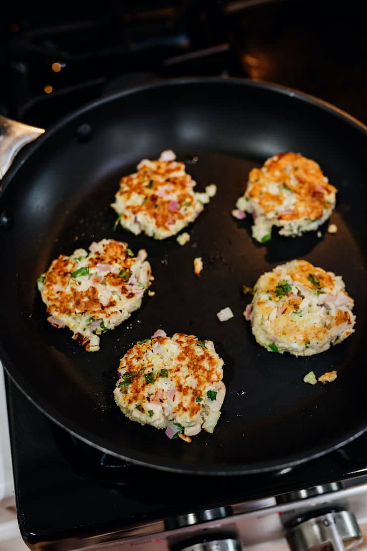 tuna patties lightly pan fried in a non-stick skillet