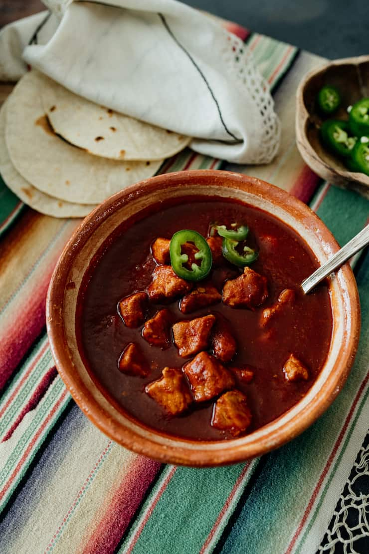 bowl of Asado de Chile Colorado (Pork in Red Chile Sauce)