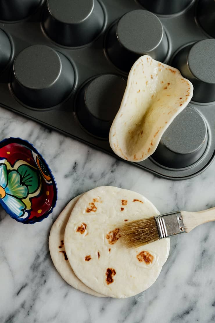flipped muffin tin with flour tortillas to make dessert tacos