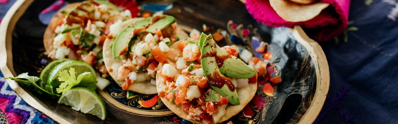 ceviche style canned salmon salad on three tostadas