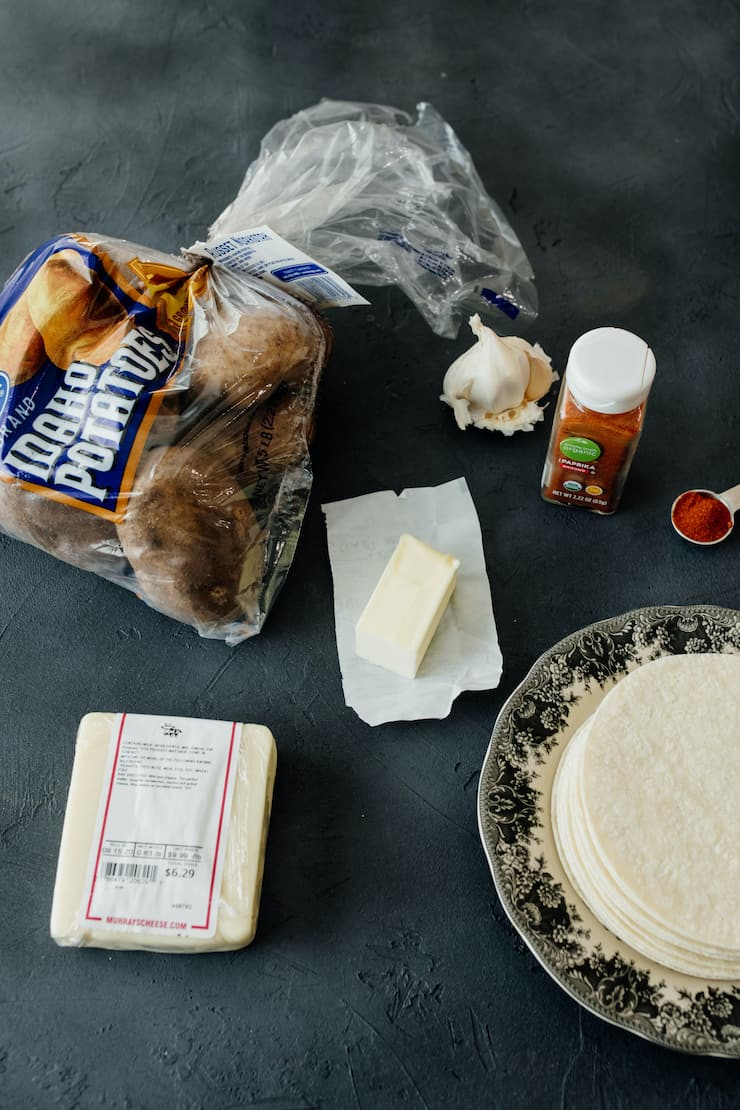 vegetarian taco ingredients - potatoes, butter, cheese, tortillas, garlic, spices