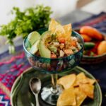 canned salmon salad ceviche style served in a glass with avocado slices and tortilla chips
