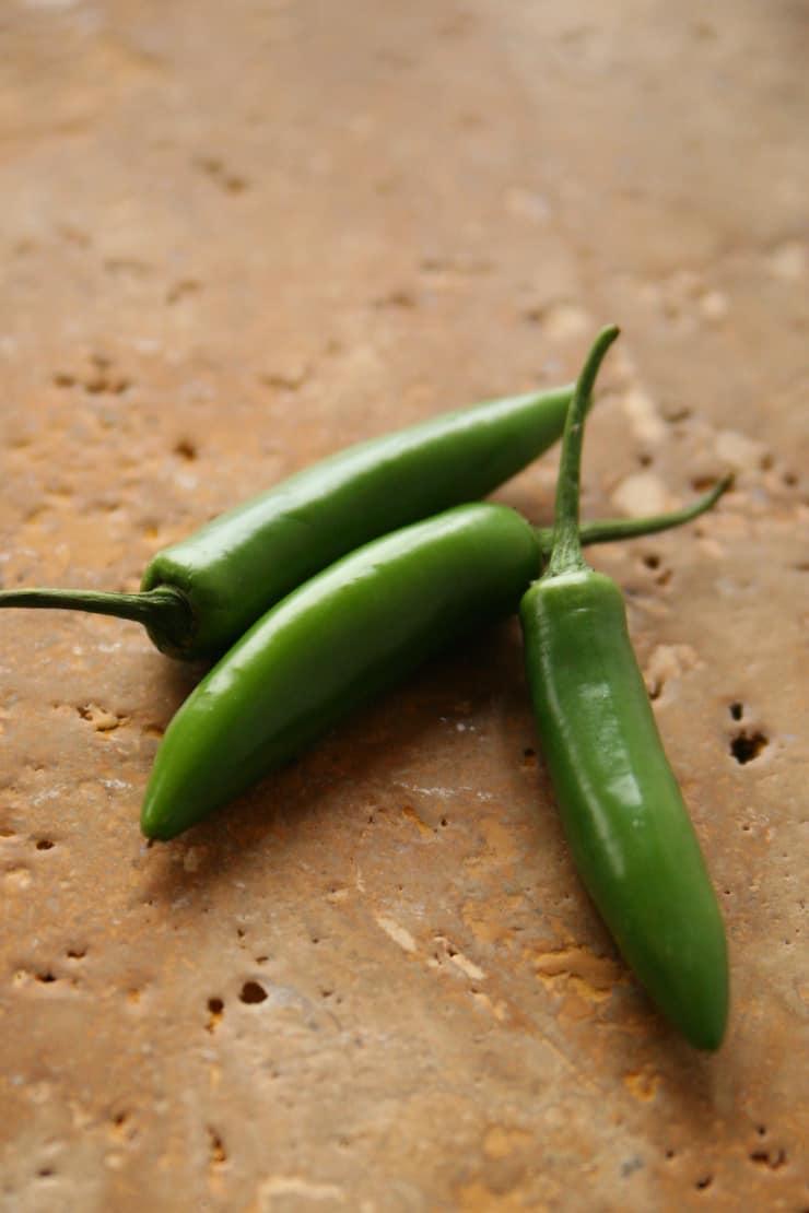 three serrano chile peppers
