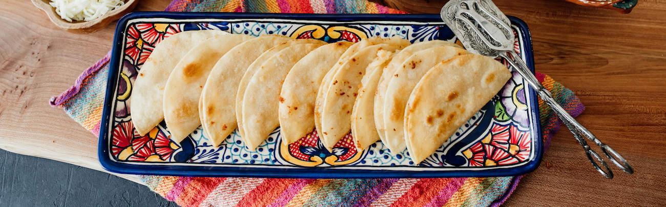 crispy vegetarian potato tacos on a platter