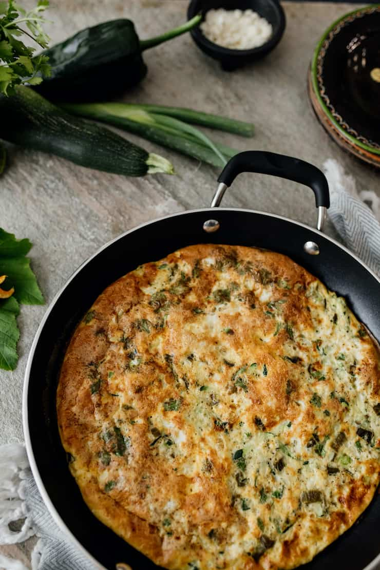 poblano and zucchini vegetable frittata in pan