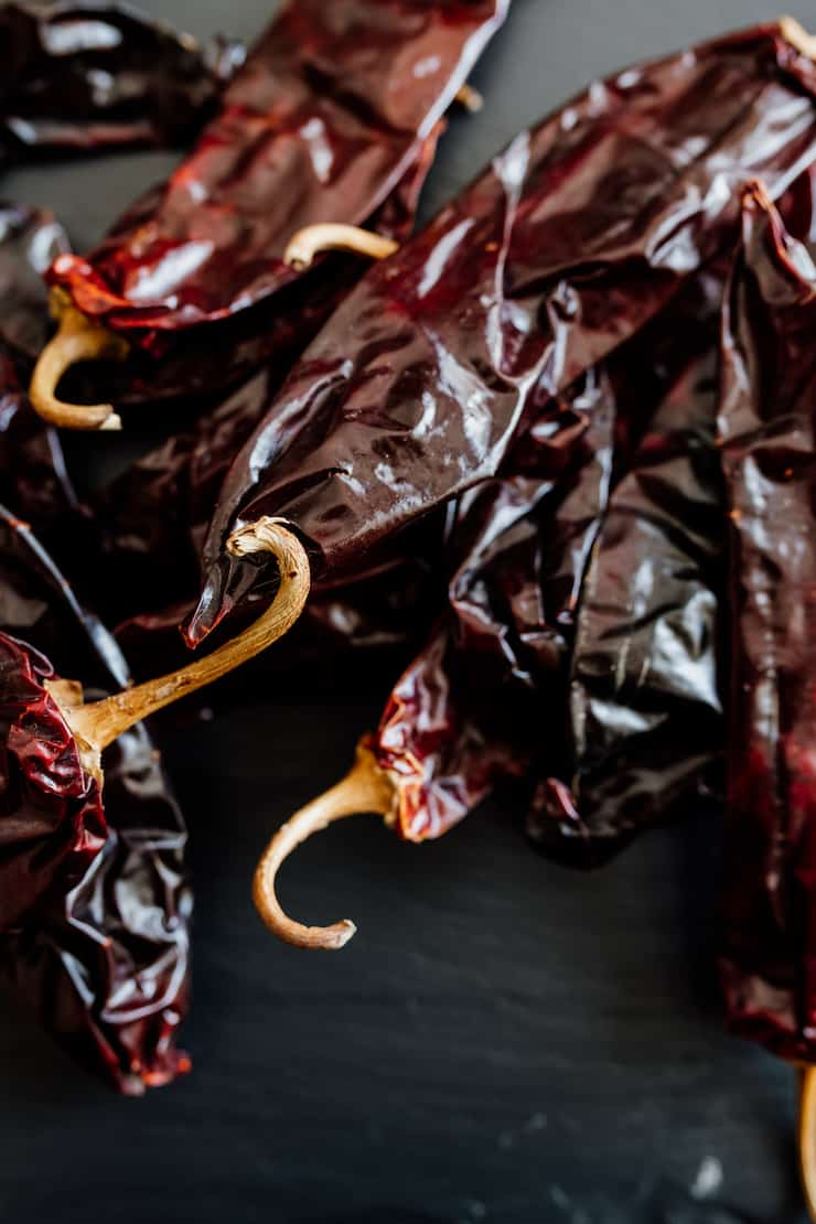 dried New Mexico Chile pods on a black background