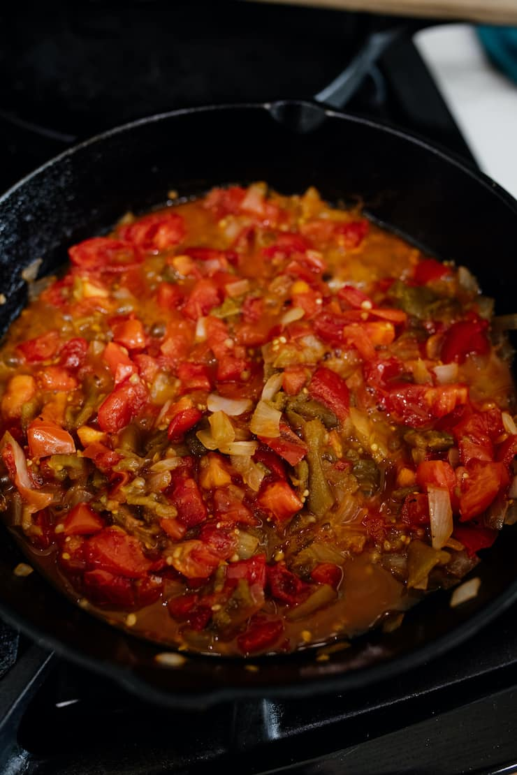 cooked salsa for huevos rancheros recipe in a cast iron skillet