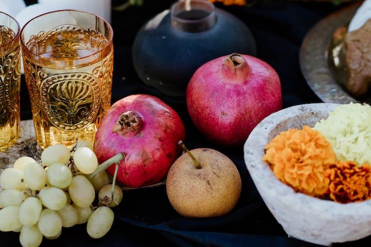 drinks water and fruit marigolds on day of the dead die de Muertos altar
