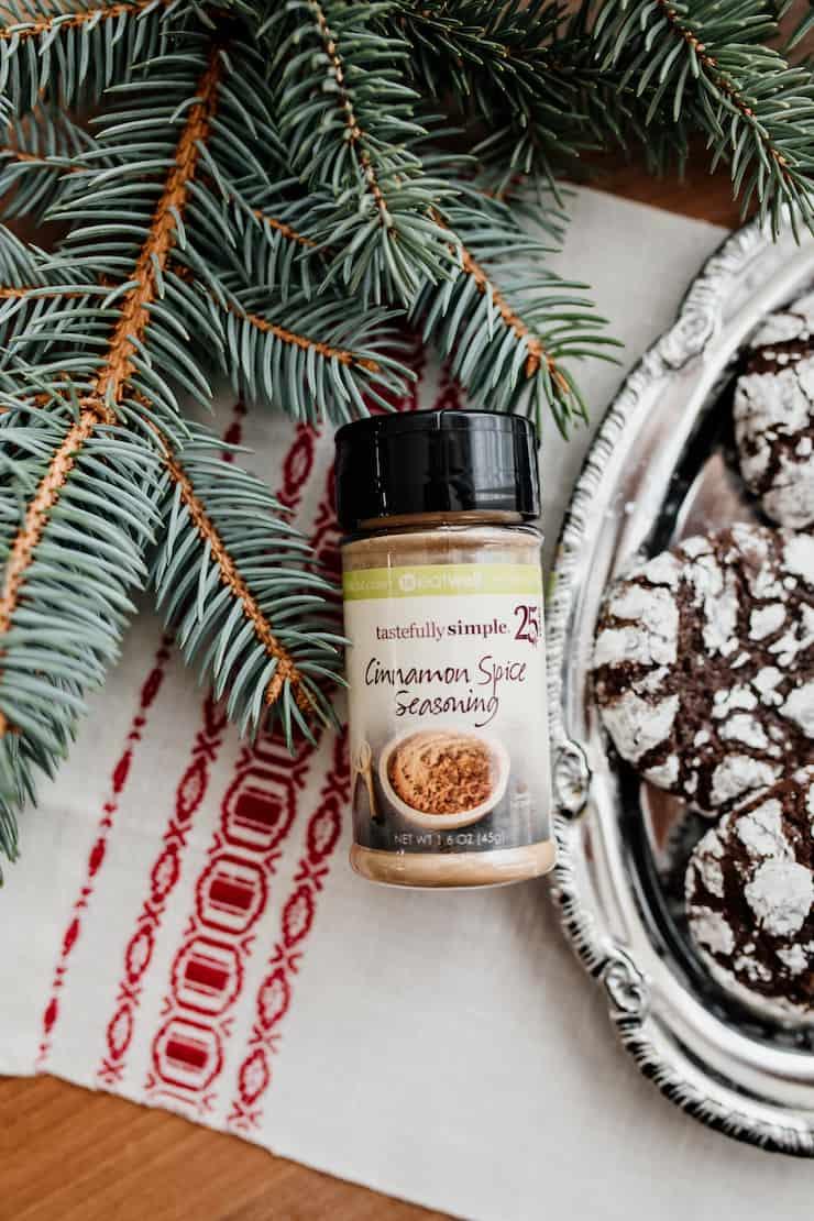 tastefully simple cinnamon spice seasoning jar next to a platter of cookies