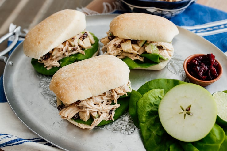 chicken salad with apples on ciabatta rolls on a silver platter