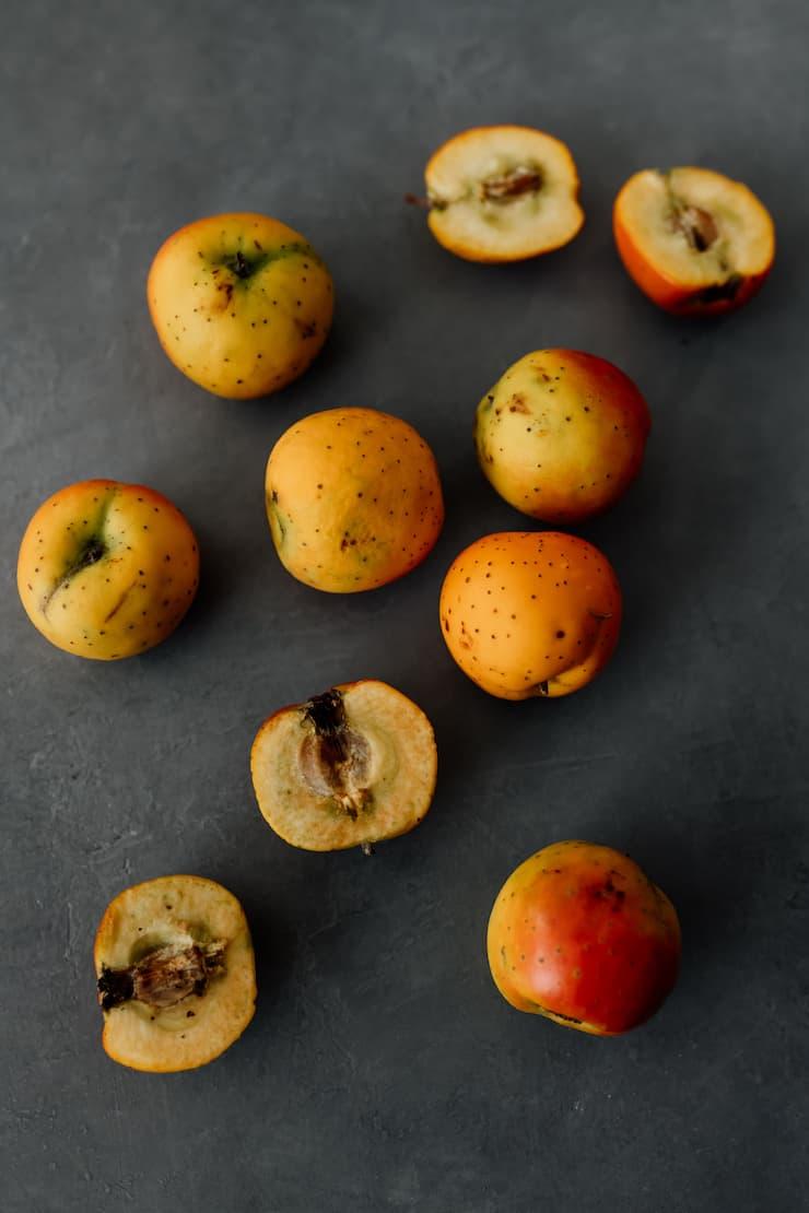 tejocotes (hawthorne apples) on a grey background