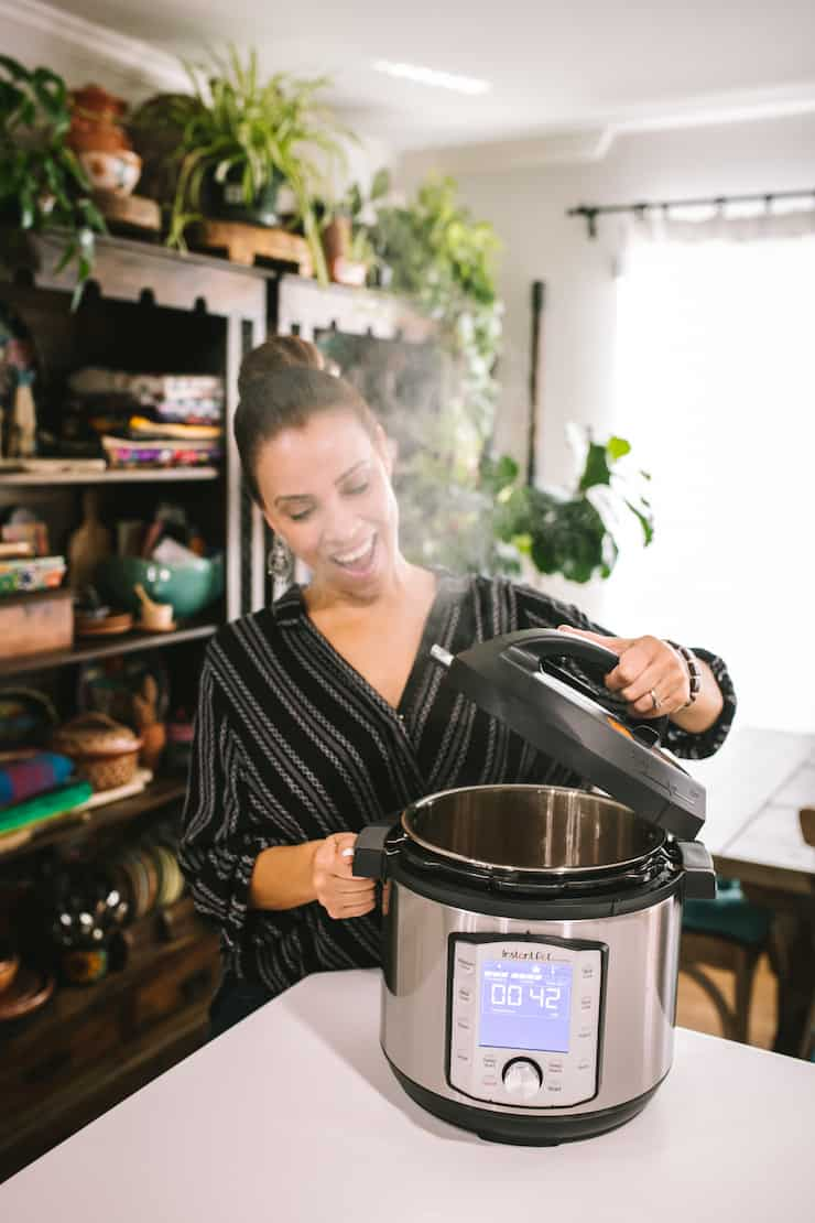 latina opening the lid of an instant pot