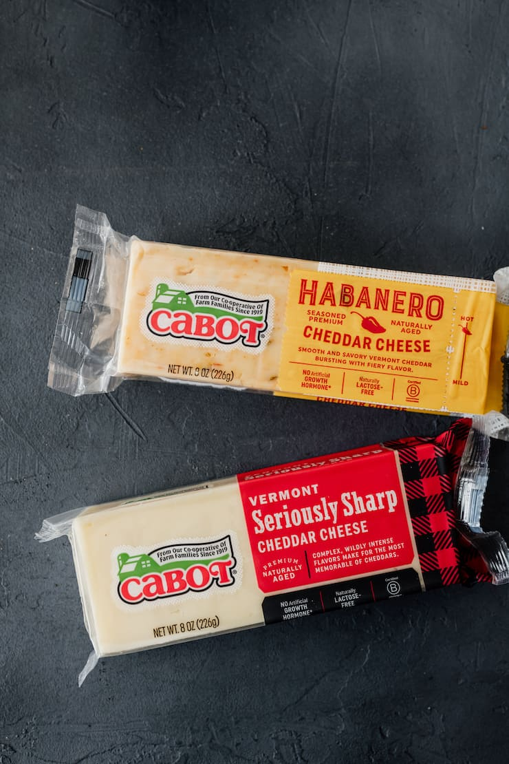 cabot habanero cheddar cheese and seriously sharp cheddar cheese on a grey background