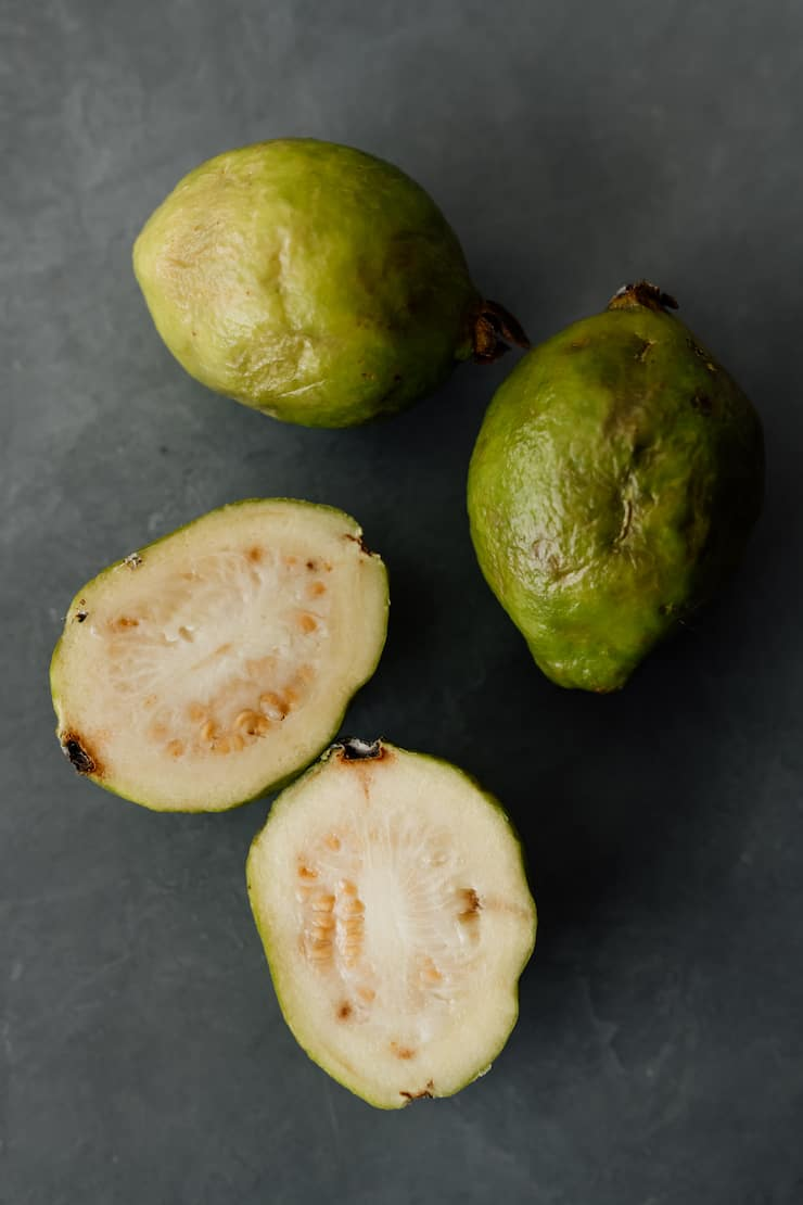 green guavas on a grey background
