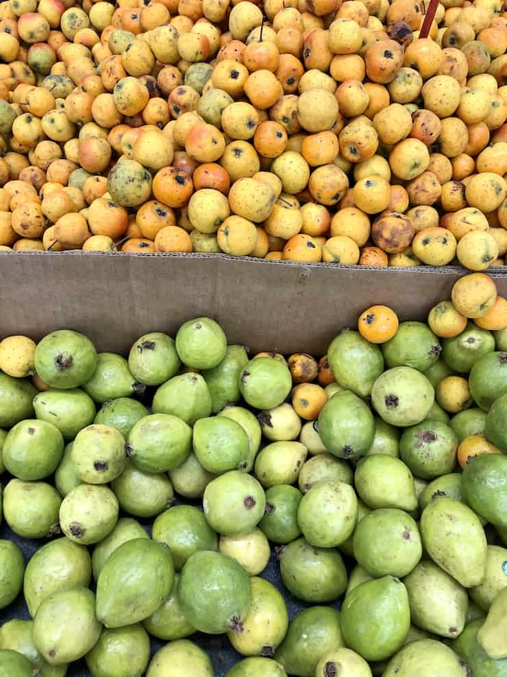 baskets of tejocotes (hawthorne apples) and guava at the supermarket
