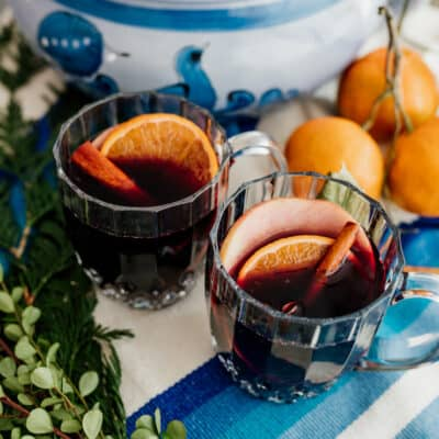 mulled wine in clear mugs on a blue and white tablescape