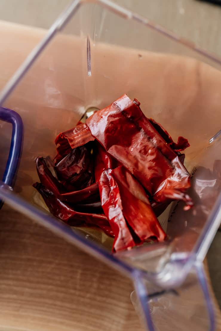 soaked dried red chiles in blender pitcher