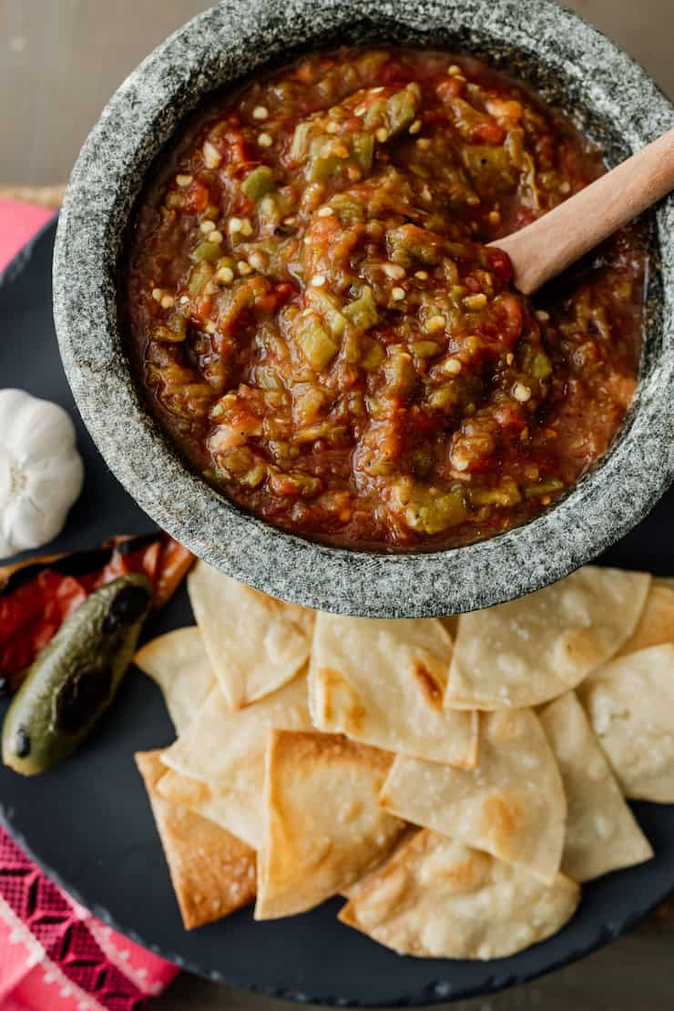 fire roasted tomato salsa with green chiles in a stoneware mortar with homemade tortilla chips