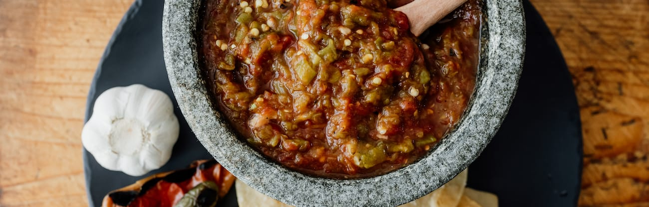homemade canned tomato salsa in a stone bowl