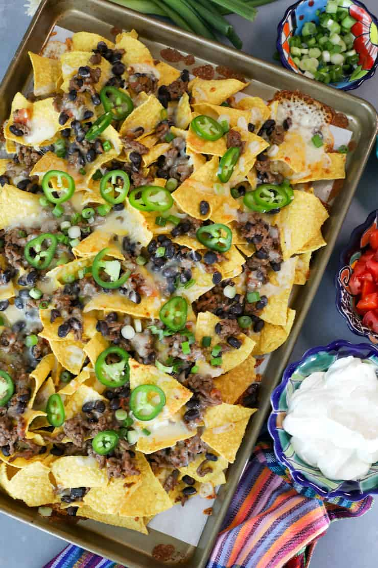 overhead shot of sheet pan nachos with ground beef and beans